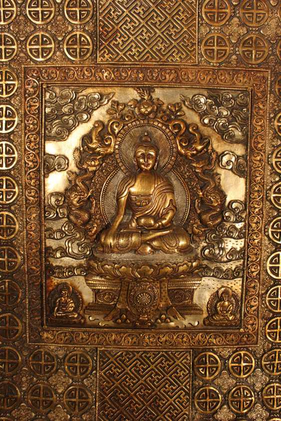 Tibetian altar panel showing Shakyamuni with two Bodhisattva godnesses at his feet and surrounded by dragons Makarasana and Utpala and other rich ornamental and floral decorations - photo 2