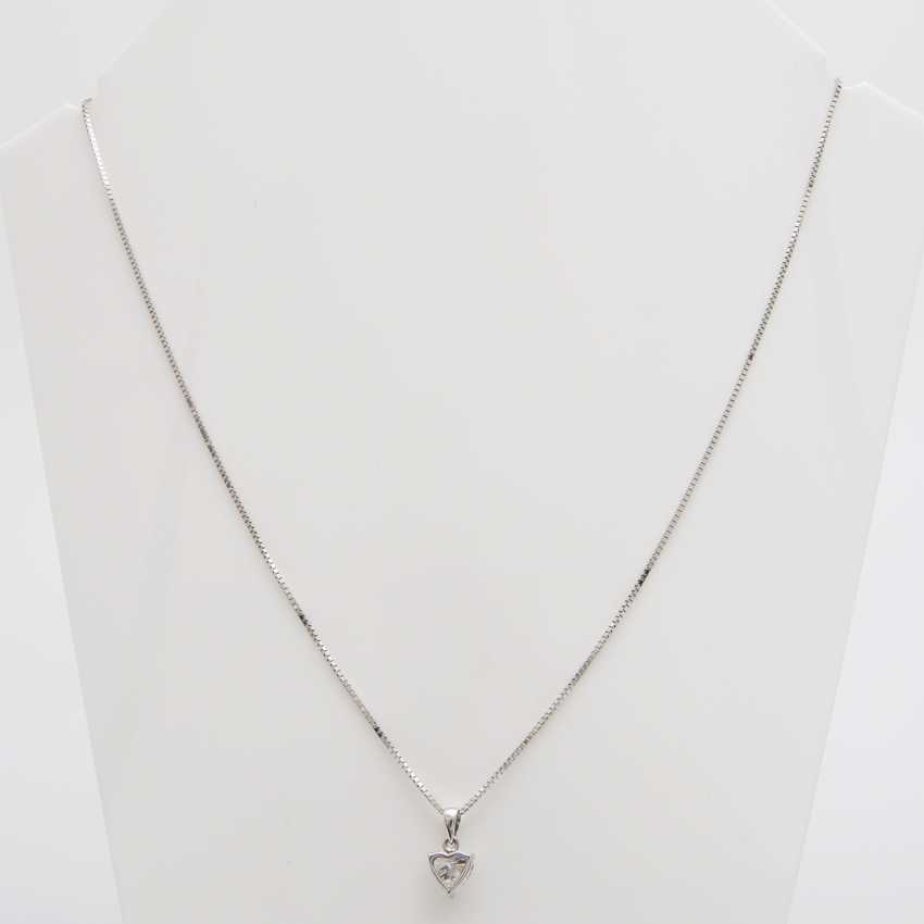 Pendant with a diamond in heart cut - photo 1