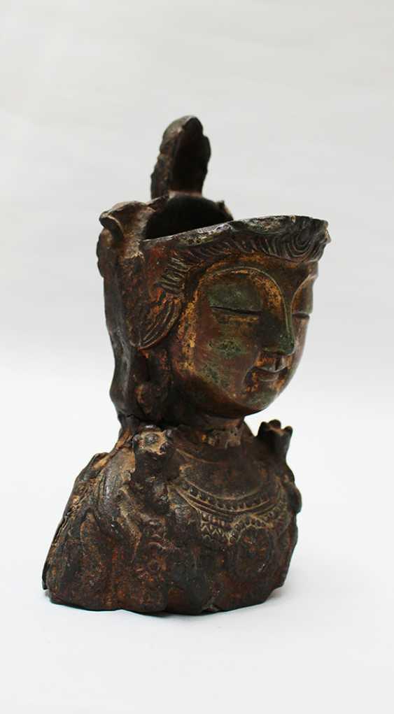 Head of an asian godness - photo 3