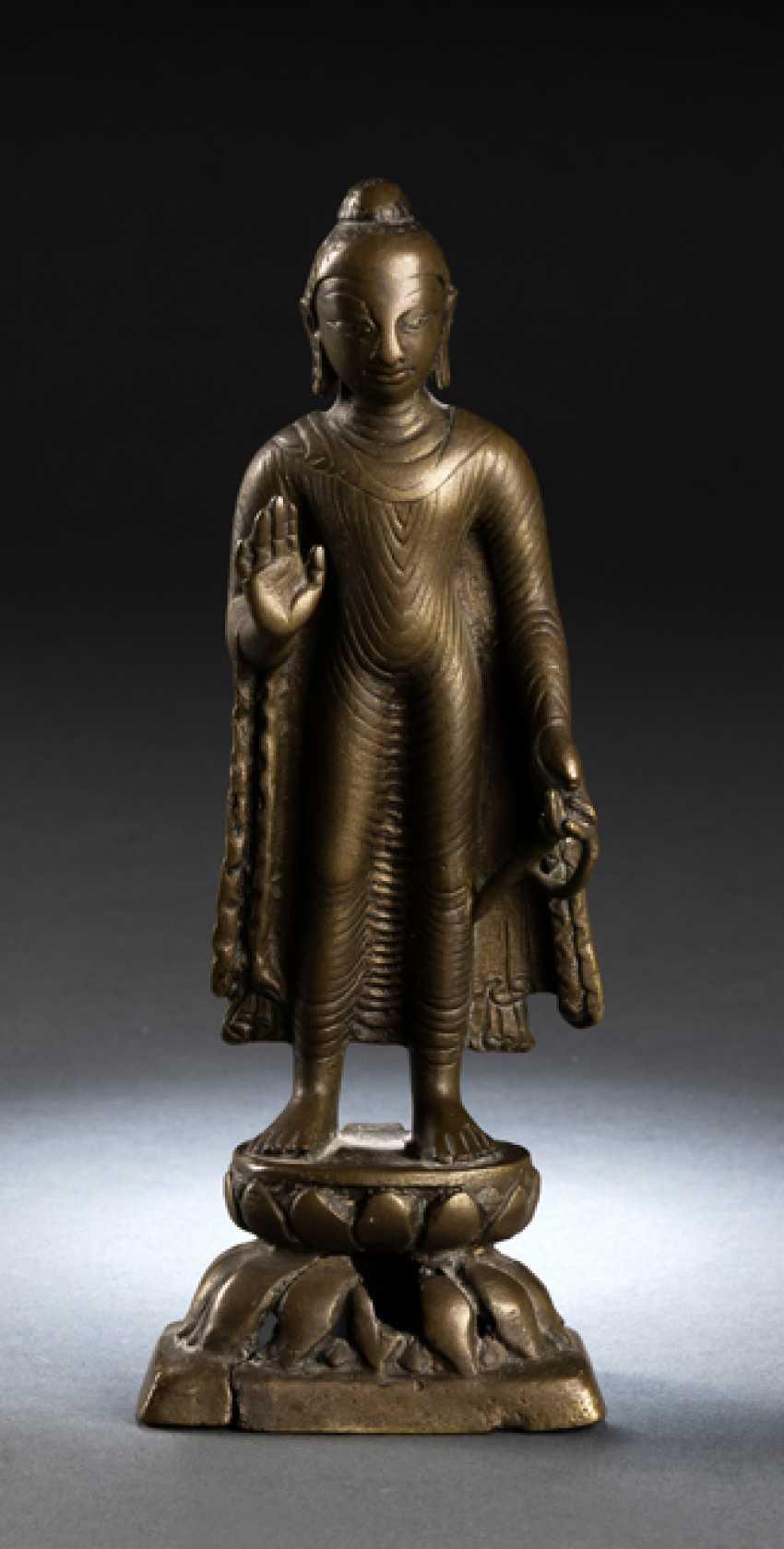 Bronze of Buddha Shakyamuni with silver deposits on a Lotus - photo 1