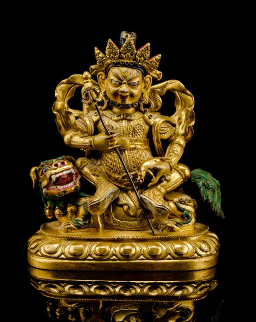 Fine fire-gilded Bronze Vaishravana on lion with a rod of silver - photo 1