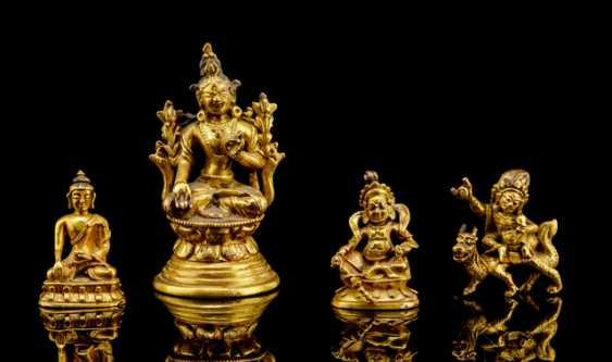 Four fire miniature bronze figures, including Buddha Shakyamuni, Vasihravana and Jambhala gold plated  - photo 1