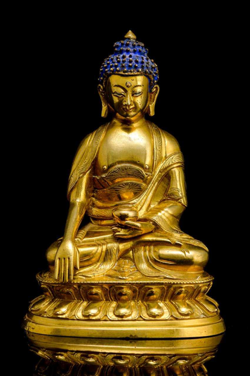 Fire-gilt Bronze of the Buddha Shakyamuni on a Lotus - photo 1
