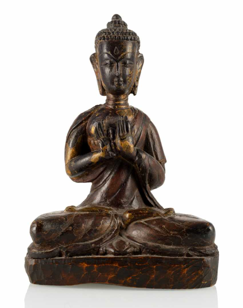 Figure of Buddha made of hard wood with remains of collection - photo 1