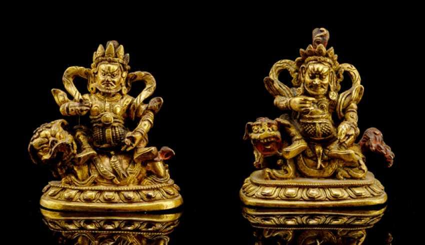 Two fire-gilded bronzes of Vaishravana on lion, with traces of color version - photo 1