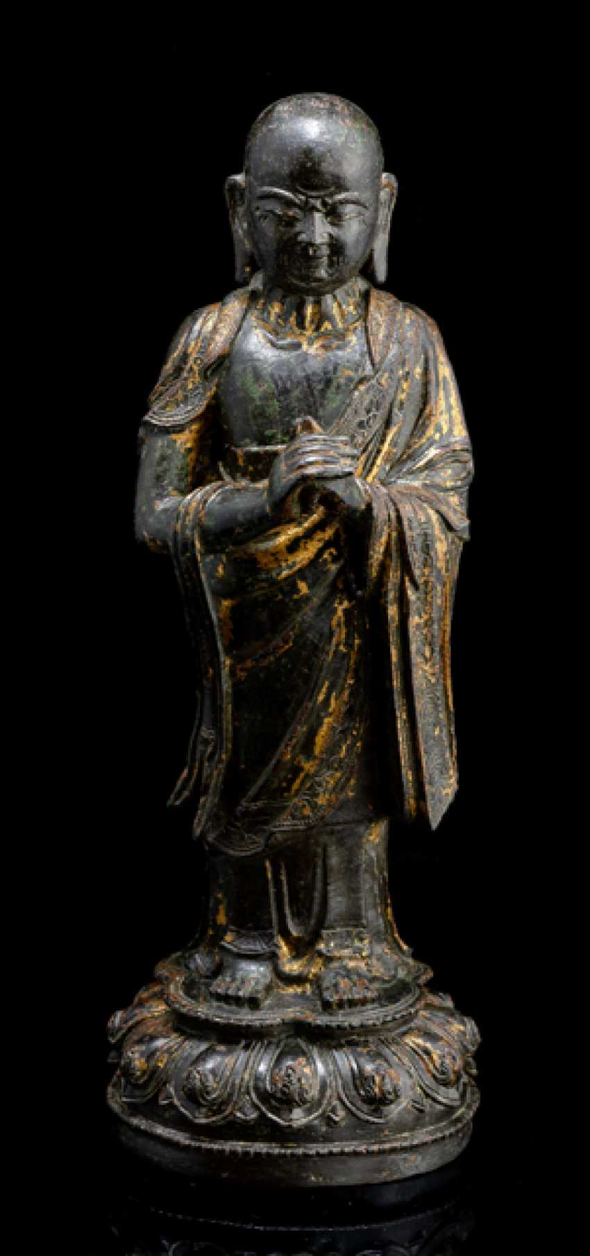 Bronze of a standing monk - photo 1