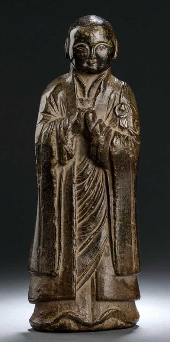 Limestone figure of a Buddhist disciple - photo 1