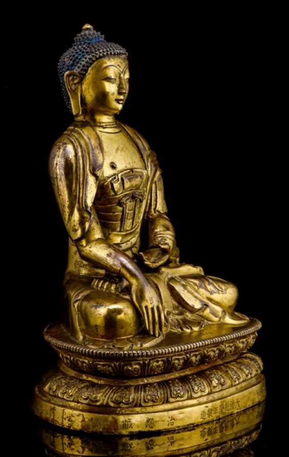 Fire-gilt Bronze of the Buddha Shakyamuni on a Lotus - photo 3