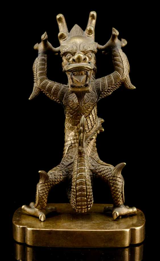 Bronze of a standing dragon on a Bronze - photo 1