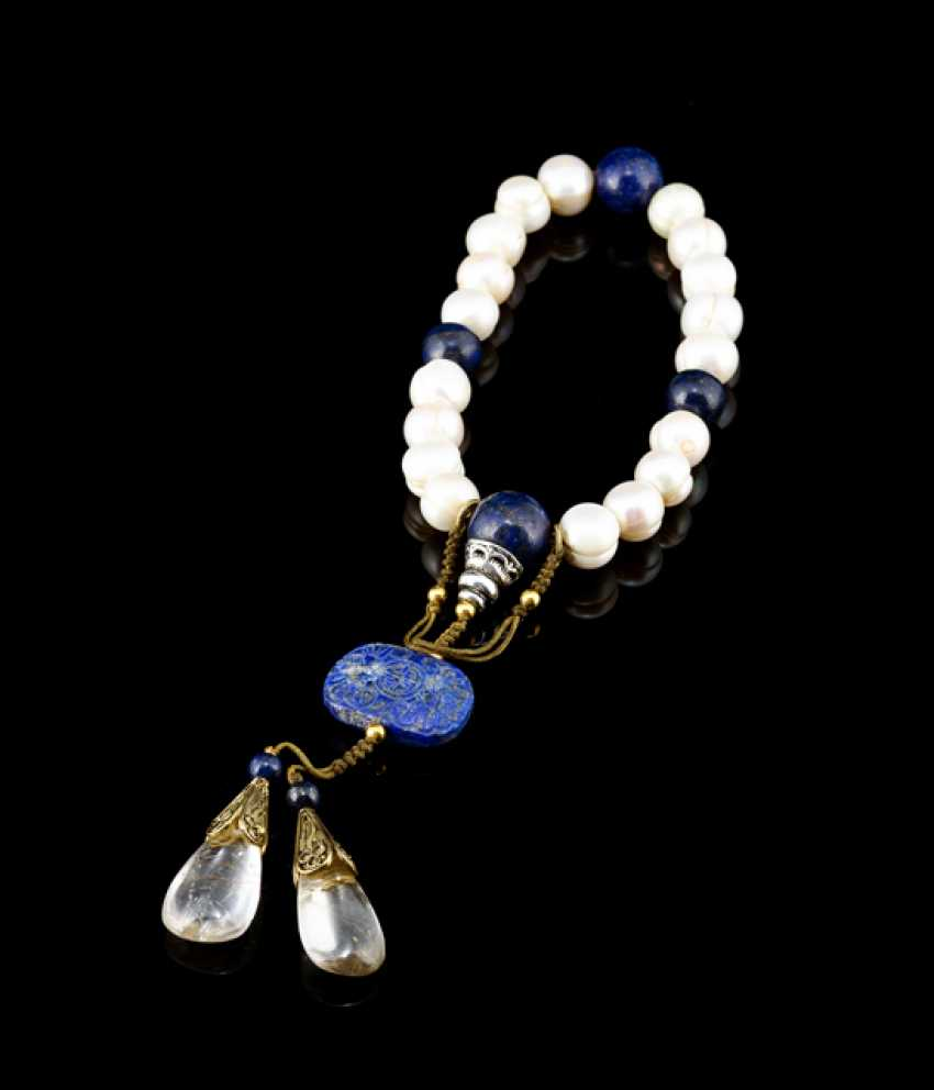 Bracelet with blue jewelry stones and pendants made from cultured pearls - photo 1