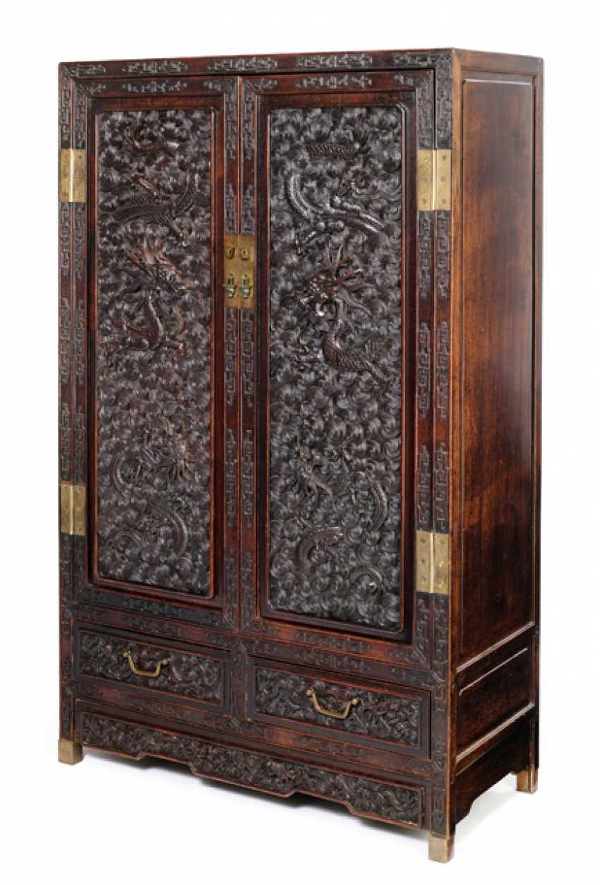 Some fine cabinets were made of hard wood with dragon decoration and metal fittings - photo 1