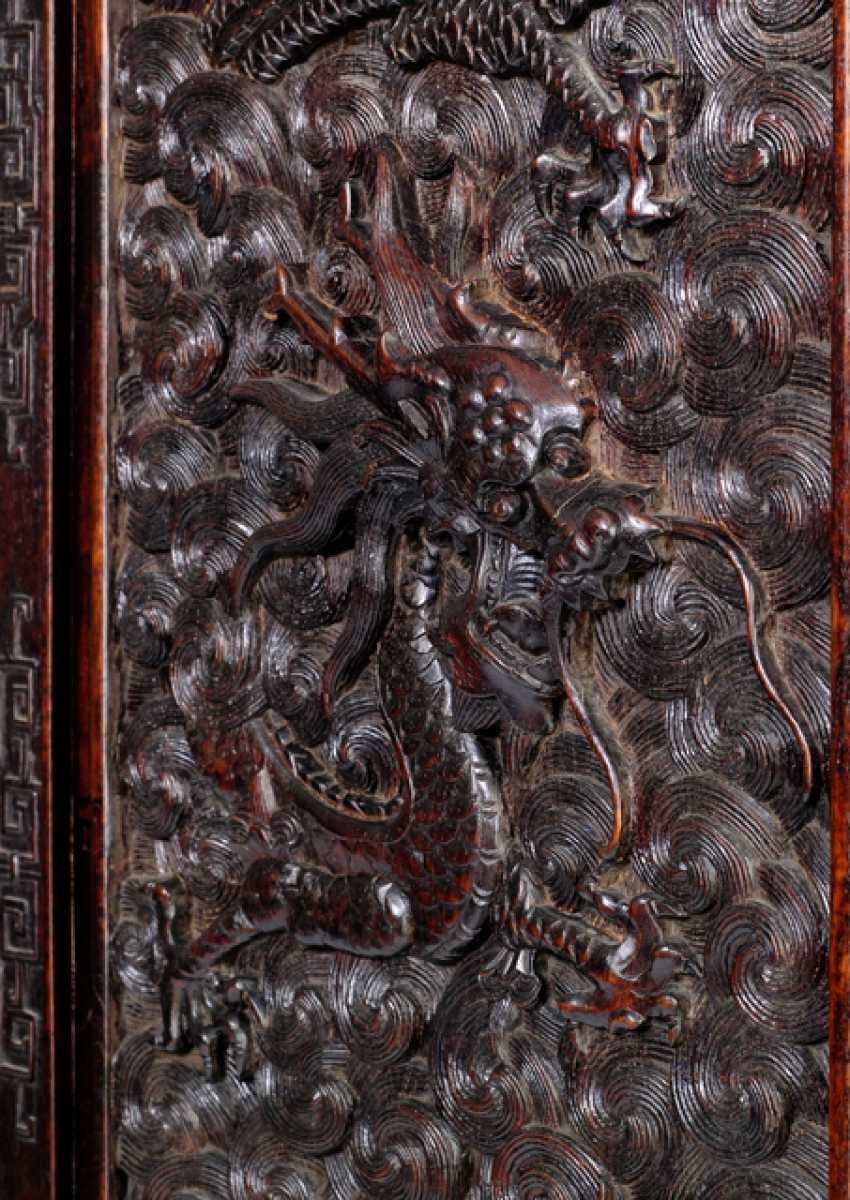 Some fine cabinets were made of hard wood with dragon decoration and metal fittings - photo 2