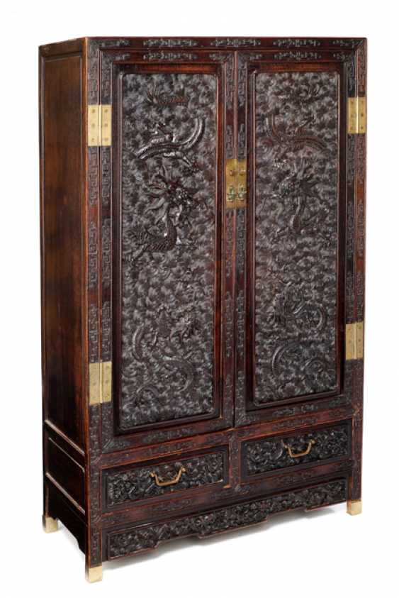 Some fine cabinets were made of hard wood with dragon decoration and metal fittings - photo 3