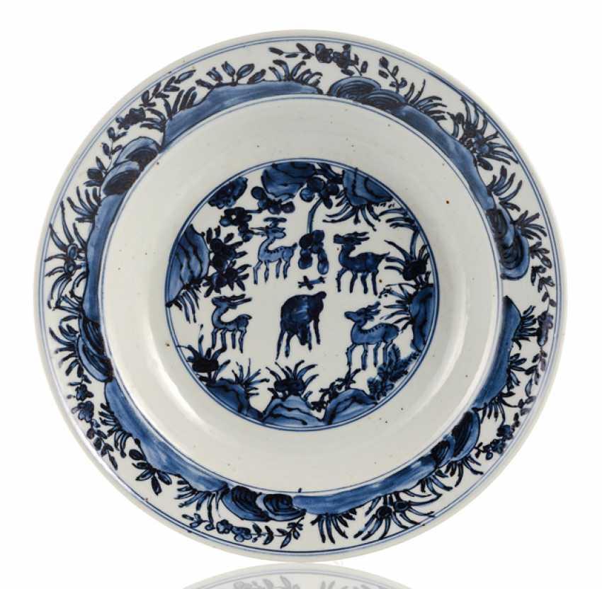 Porcelain bowl with under glaze blue decoration of a deer - photo 1