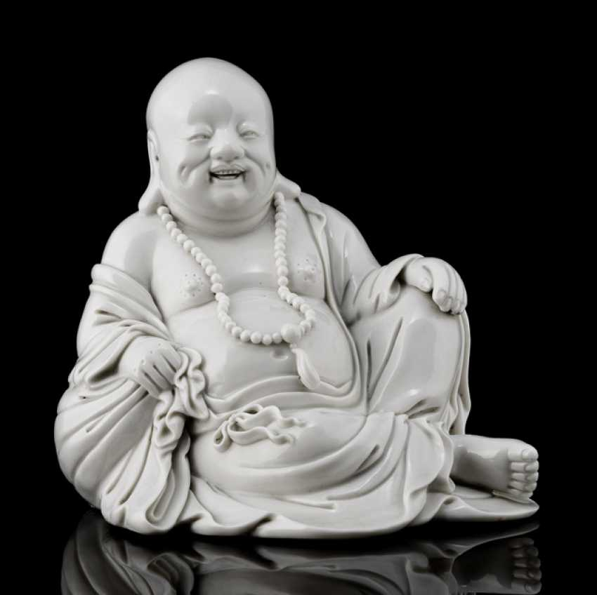 Dehua figure of Budai in a relaxed posture - photo 1