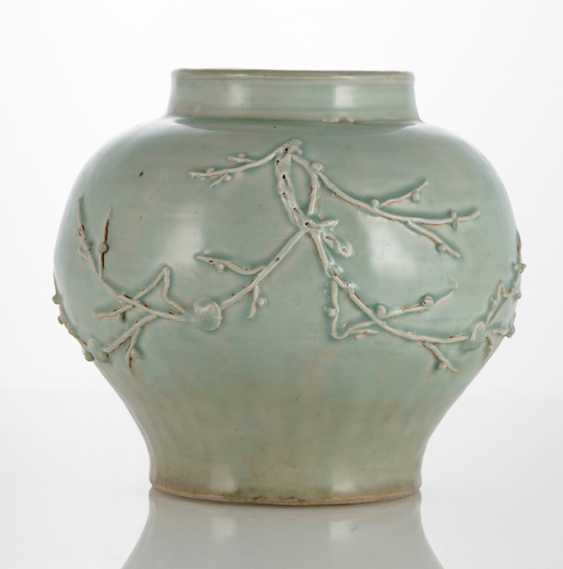 Celadon pot with relief decoration of plum branches - photo 1