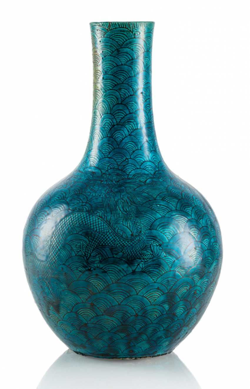 Petrol blue glazed Vase made of porcelain with a dragon between waves - photo 1