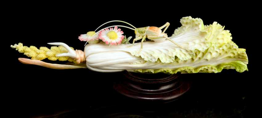 Ivory carving of a grasshopper on a cabbage in a partly colored version - photo 1