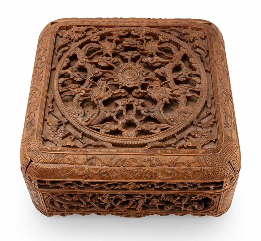 Cover can with in breakthrough carved dragon decoration made of wood - photo 1