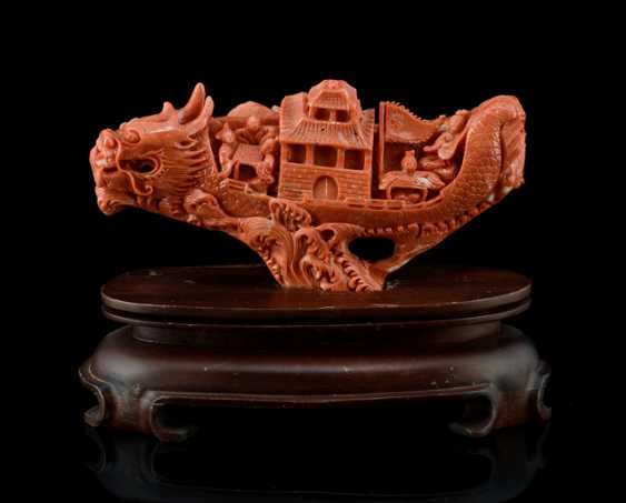 Red coral carving of a dragon boat with passengers - photo 1
