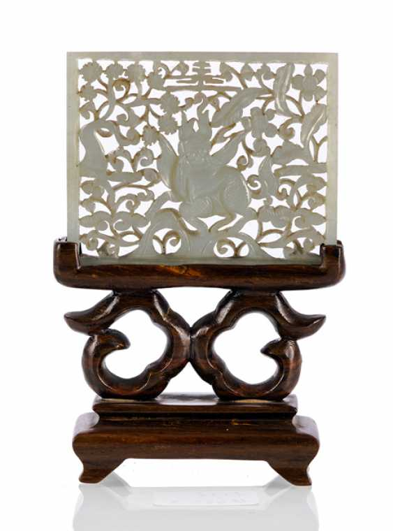 Fine plaque of light green Jade with a Qilin on a wooden stand - photo 1