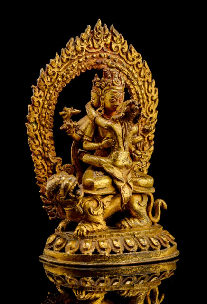 Gilded Bronze of Manjushri on a lion over a Lotus sitting - photo 1