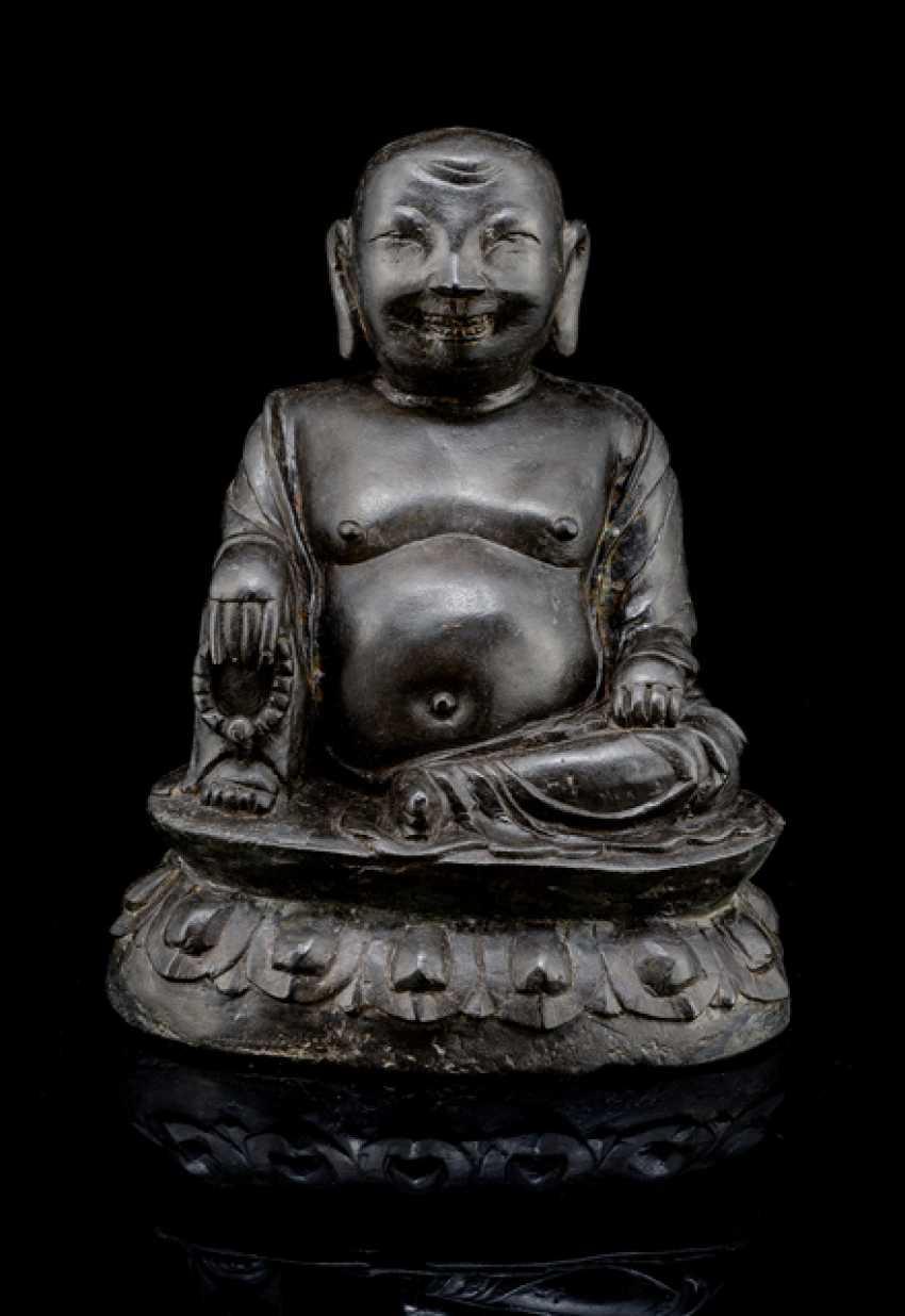 A Bronze sculpture of a seated Budai - photo 1