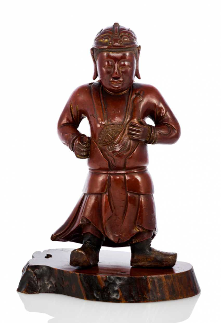 Figure of a boy in a suit of armor, dressed in wood with varnish edition - photo 1