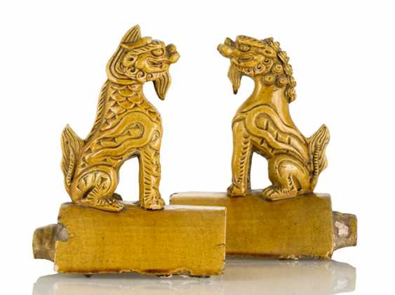 Pair of yellow glazed roof riders with fabulous animals - photo 1