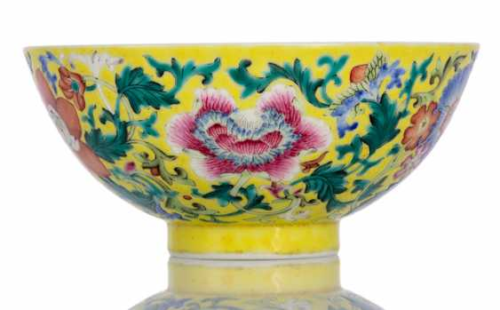 Bowl with flower painting on yellow background - photo 1