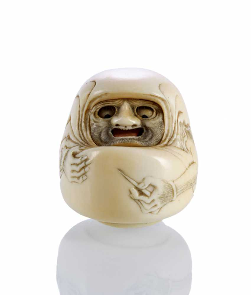 Lot 1020  Daruma doll made of ivory with moving eyes and