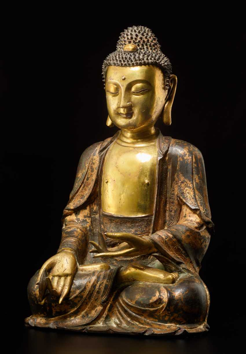 A PARTIALLY FIRE-GILT BRONZE OF THE MEDICINE BUDDHA, BHAISHAJYA-GURU - photo 1