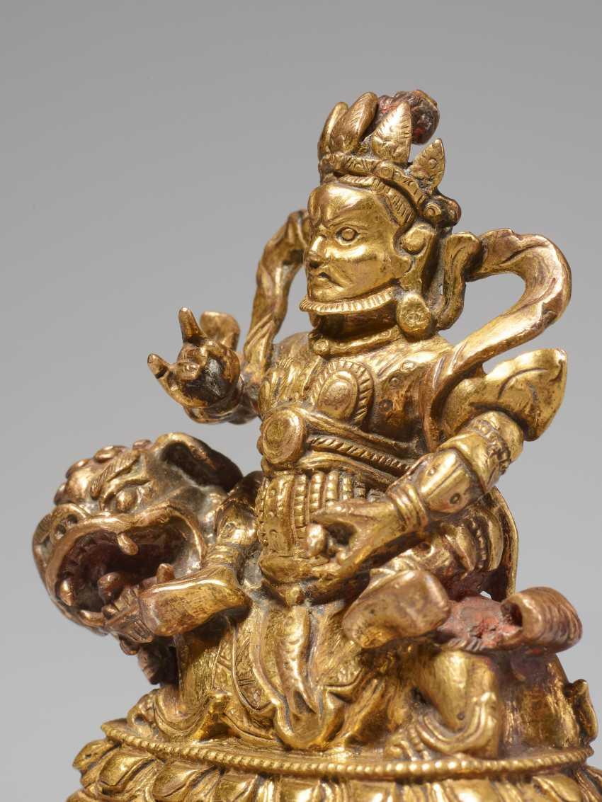 VAISHRAVANA - THE KEEPER OF THE TREASURES ON HIS LION
