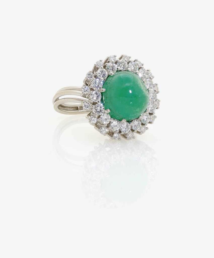 Entourage ring decorated with an emerald and brilliants . Germany, 1950s-1960s - photo 1