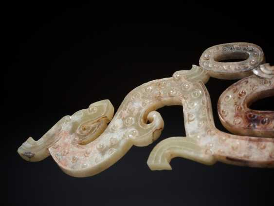 SPIRAL HORNED DRAGON WITH A YOUNG COUNTERPART TO THE FAMOUS DRAGON AMULET AT THE MUSÉE GUIMET
