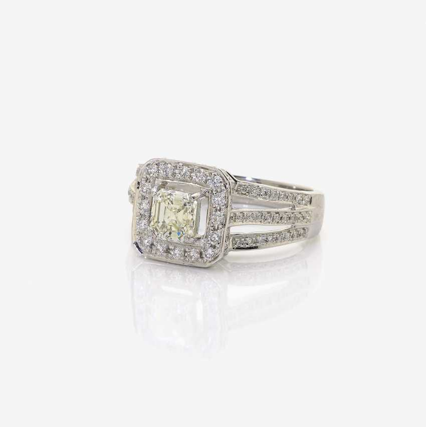 Cocktail ring decorated with a diamond in the Emerald Cut and brilliant-cut diamonds . England, London, 2000s - photo 1
