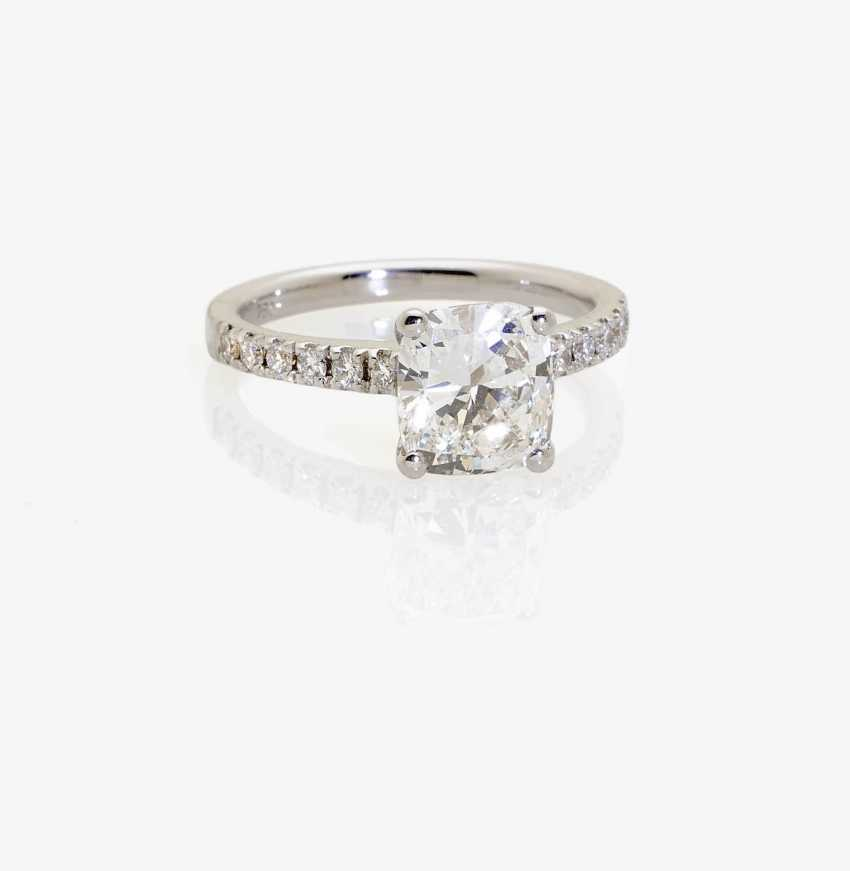 Classical, modern solitaire ring decorated with a diamond-brilliant Cushion-Cut . England to 2000s - photo 1