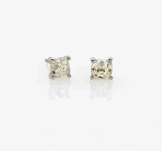 A PAIR OF STUD PIN PLUG DECORATED WITH DIAMONDS IN OLD EUROPEAN CUT . England, 1940s - photo 1