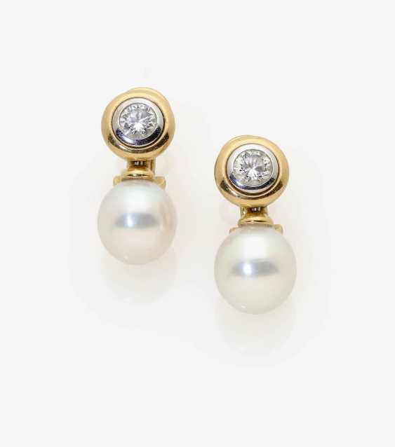 A Pair of ear clip/plug set with diamonds and cultured pearls. - photo 1