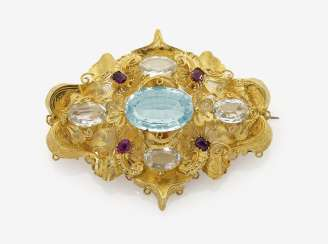 Brooch with aquamarine and rubies