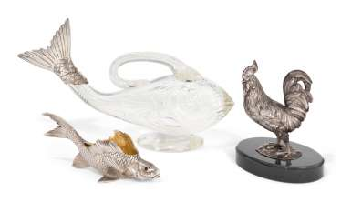 A SILVER-MOUNTED CUT-GLASS FISH-FORM CLARET JUG, A GEM-SET SILVER FISH-FORM SALT, AND A SILVER MODEL OF A COCKEREL