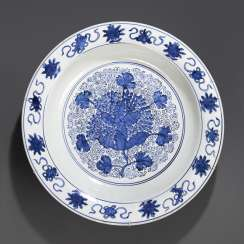Large under glaze blue circular porcelain plate decorated with grapes decor