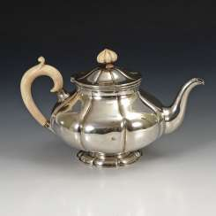 Silver teapot with ivory handle.