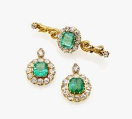 Brooch and a pair of earrings with emeralds and diamonds