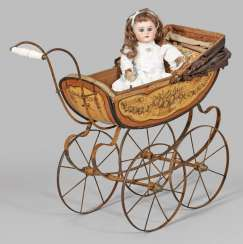 Small jointed doll by Armand Marseille with a doll's pram