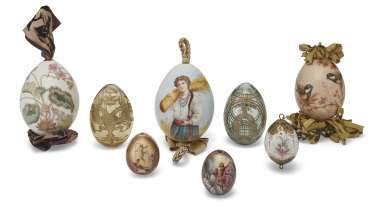A GROUP OF EIGHT PORCELAIN AND GLASS EASTER EGGS