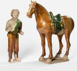 'Sancai'-glazed porcelain horse with a horse guide