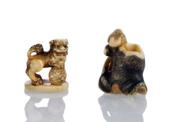 Two Netsuke: Buddhist lion with Ball and bird on tree trunk in ivory worked