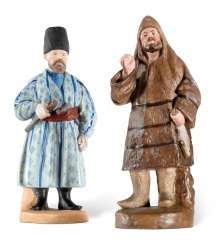 A PORCELAIN FIGURE OF A COSSACK AND A PORCELAIN FIGURE OF A LAPLANDER FROM THE 'PEOPLES OF RUSSIA' SERIES