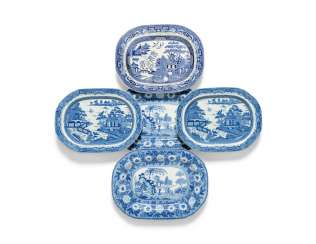 OLIVER MESSEL'S BLUE AND WHITE PLATTERS FROM MADDOX, BARBADOS:FIVE ENGLISH BLUE AND WHITE PLATTERS